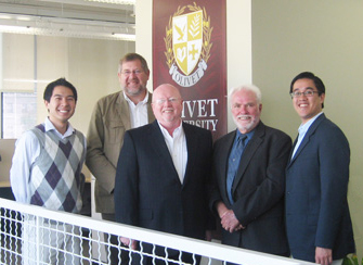 Dr. Geoff Tunncliffe (center) and Dr. Rob Brynjolfson (center, left) met with Olivet University leaders in July to finalize the partnership.