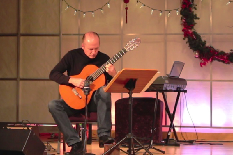olivet-university-jubilee-school-instructor-gives-classical-guitar-performance